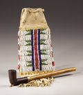 American Indian Art:Beadwork, AN ARAPAHO BEADED HIDE POUCH. . c. 1890. ...