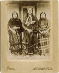 Photography:Cabinet Photos, QUANAH PARKER AND WIVES - BOUDOIR CARD - ca. 1890. Comanche ChiefQuanah Parker stands proudly by his wives, To-pay and Cho-...(Total: 1 Item)