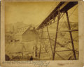 """Photography:Official Photos, IMPRESSIVE LOCKE IMAGE OF THE HOMESTAKE GOLDMINE AT DEADWOOD. Taken circa 1885, this large 8.75"""" x 7"""" sepia image depicts th... (Total: 1 Item)"""