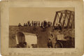 "Photography:Cabinet Photos, KANSAS WAGON TRAINS - CROSSING RAILROAD BRIDGE - BOUDOIR CARD -ca.1890.""600 wagons crossing Salt Fork river on R.R. Bridge""...(Total: 1 Item)"