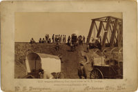 "KANSAS WAGON TRAINS - CROSSING RAILROAD BRIDGE - BOUDOIR CARD - ca.1890.""600 wagons crossing Salt Fork river on R.R..."