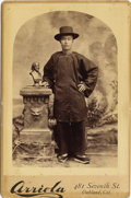Photography:Cabinet Photos, CHINESE IMMIGRANT WEARING HAT - CALIFORNIA CABINET CARD - ca.1885.An Oakland, California cabinet card of an Asian man weari...(Total: 1 Item)