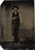 Photography:Tintypes, YOUNG COWBOY DISPLAYS A MERWIN-HULBERT REVOLVER - 1/6TH PLATETINTYPE - ca.1875. This cowboy has an unusual Merwin &Hulbert... (Total: 1 Item)