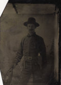 Photography:Tintypes, ARMED WESTERNER WITH BOWIE KNIFE - 1/6TH PLATE TINTYPE - ca. 1875-85. A western man displays his small Bowie knife, and a sm... (Total: 1 Item)