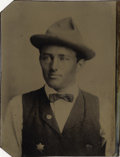Photography:Tintypes, YOUNG LAWMAN OR DEPUTY SHERIFF WITH BADGE - 1/6TH PLATE TINTYPE -ca.1875-85. A six-point star adorns the chest of this youn...(Total: 1 Item)