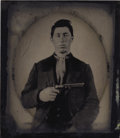 Photography:Tintypes, YOUNG RUFFIAN WITH COLT 1849 POCKET REVOLVER - 1/6TH PLATE TINTYPE - ca.1860-70. An early tintype of a very tough-looking gu... (Total: 1 Item)