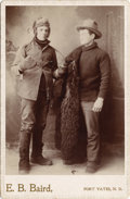 Photography:Cabinet Photos, FT. YATES, N.D. BUFFALO JACKET ICE MEN - CABINET CARD - ca.1890-1900. The man on the left has a set of ice hooks, fur mitte...(Total: 1 Item)
