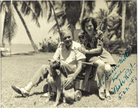 1947 Babe Ruth Signed Photograph. A rather frail looking Bambino relaxes in a tropical setting in the company of his wif...