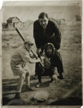Autographs:Photos, 1932 Babe Ruth Oversized Culver Service Photograph, Type 1. Simply charming sandlot shot finds the Babe operating as an ump...