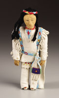 American Indian Art, A SIOUX BEADED CLOTH AND WOOD MALE DOLL. c. 1950...