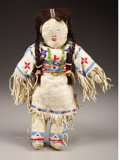 American Indian Art, A SIOUX BEADED HIDE FEMALE DOLL. c. 1940...