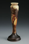 Art Glass:Daum, A FRENCH GLASS VASE. Daum Nancy, French, c.1930s. The footed baluster form cameo vase in an orange and yellow ground overl...