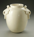 Ceramics & Porcelain, American:Modern  (1900 1949)  , AN AMERICAN POTTERY VASE. Weller, c.1935. Of 'Ivories' pattern, theclassic body with applied acanthus with ring handles o...
