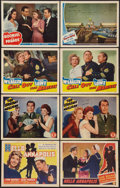 "Movie Posters:War, World War II Military Lot (Various, 1941-42). Title Lobby Card& Lobby Cards (7) (11"" X 14""). War.. ... (Total: 8 Items)"