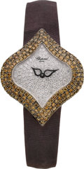 Estate Jewelry:Watches, Chopard Lady's Colored Diamond, Diamond, White Gold PushkinWristwatch, modern. ...