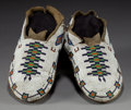 American Indian Art:Beadwork and Quillwork, A PAIR OF PLAINS CREE BEADED HIDE MOCCASINS. c. 1900... (Total: 1Pair)