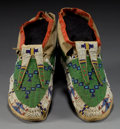 American Indian Art:Beadwork and Quillwork, A PAIR OF SIOUX BEADED HIDE MOCCASINS. c. 1890... (Total: 1 Pair)