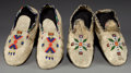 American Indian Art:Beadwork and Quillwork, TWO PAIRS OF SIOUX BEADED HIDE MOCCASINS... (Total: 2 Pair)