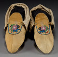 American Indian Art:Beadwork and Quillwork, A PAIR OF CHIPPEWA BEADED HIDE MOCCASINS... (Total: 1 Pair)