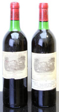 Red Bordeaux, Chateau Lafite Rothschild 1982 . Pauillac. 1bn, 1ts, 2bsl,1lnl, 1oxc. Bottle (2). ... (Total: 2 Btls. )