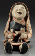 American Indian Art:Pottery, A COCHITI POLYCHROME STORYTELLER. Ada Suina. c. 1980...