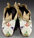 American Indian Art:Beadwork and Quillwork, A PAIR OF CHEYENNE BEADED HIDE MOCCASINS. c. 1910... (Total: 1Pair)