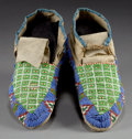 American Indian Art:Beadwork and Quillwork, A PAIR OF SIOUX BEADED HIDE MOCCASINS. c. 1910... (Total: 1 Pair)