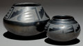 American Indian Art:Pottery, TWO SAN ILDEFONSO BLACKWARE JARS. Maria and Julian Martinez. c.1930... (Total: 2 Items)