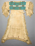 Paintings, AN ARAPAHO GIRL'S BEADED AND FRINGED HIDE DRESS. c. 1890. ...