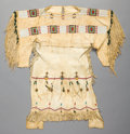 American Indian Art:Beadwork and Quillwork, A CHEYENNE GIRL'S BEADED AND FRINGED HIDE DRESS. c. 1900...