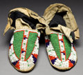 American Indian Art:Beadwork and Quillwork, A PAIR OF SIOUX BEADED HIDE MOCCASINS. c. 1900... (Total: 1 Pair)