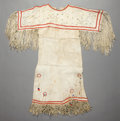 American Indian Art:Beadwork and Quillwork, A SIOUX GIRL'S BEADED AND FRINGED HIDE DRESS. c. 1920...