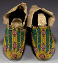 American Indian Art:Beadwork and Quillwork, A PAIR OF CHEYENNE BEADED HIDE MOCCASINS. c. 1880... (Total: 1Pair)