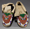 American Indian Art:Beadwork and Quillwork, A PAIR OF SIOUX CHILD'S BEADED HIDE MOCCASINS. c. 1910... (Total: 1Pair)