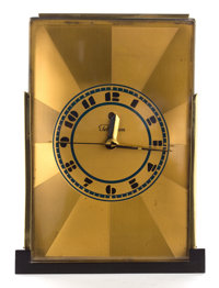 A PAUL FRANKL BRASS CLOCK BY TELECHRON Designed by Paul T. Frankl (American 1886-1958) Manufactured by Warren