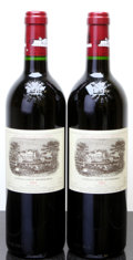 Red Bordeaux, Chateau Lafite Rothschild 2002 . Pauillac. Bottle (2). ... (Total: 2 Btls. )