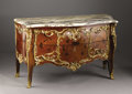 Furniture: French, A Louis XV Style Marquetry Commode. Unknown maker, France. MidNineteenth Century. Mahogany and various woods, marble, gil...