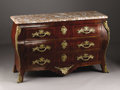 Furniture: French, A French Regence Style Commode. French. Circa 1860-1870. Mahogany,kinwood, gilt bronze and marble. 35 in. x 56 in. x 24 i...