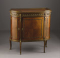 Furniture: French, A Napoleon III Kingwood and Gilt Bronze Cabinet. French. Circa1890. Kingwood, gilt bronze. 37 in. x 40 in.. With parque...