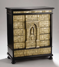 A Superb Italian Cabinet of Carved Ivory and Ebonized Wood  Unknown maker, Italy Eighteenth Century Ivory, ebonized wood...