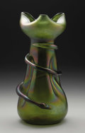 Art Glass:Loetz, An Austrian Glass Vase. Loetz, c.1900. Iridescent green vase withmagenta highlights, applied snake wraps around the b...