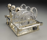 A French Art Deco Glass And Nickel Plate Tantalus  Design attributed to Jacques Adnet (French, 1901-84) Manufactured by...