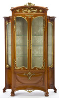 Furniture : French, A MAJORELLE WALNUT AND GILT BRONZE VITRINE . Louis Majorelle(French, 1859-1926), Nancy, France, circa 1900. Unmarked. 99 in...