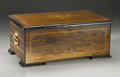 Furniture , A Swiss Musical Box. Switzerland. Late Nineteenth / Early Twentieth Century. Wood, metal components. Marks: paper tune she...