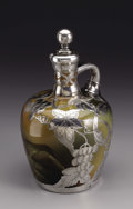 Ceramics & Porcelain, An American Art Pottery Jug with Silver Overlay. Rookwood Pottery, Cincinnati, Ohio. Painted by Charles John Dibowski. The...