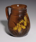 Ceramics & Porcelain, An American Art Pottery Pitcher. Rookwood Pottery, Cincinnati, Ohio. Parinted by Mathew A. Daly. 1885. Marks: ROOKWOOD,...