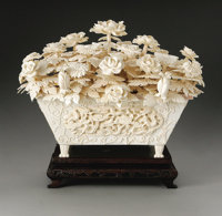 A Large Chinese Carved Ivory Floral Planter  Chinese Twentieth Century Ivory, wood 11 in. x 15.5 in. (ivory)  The rec