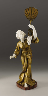 A French Cold Painted Bronze and Porcelain Figure  Ad. Cuiffier, France Circa 1890-1900 Cold painted bronze, bisque porc...