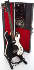 Musical Instruments:Electric Guitars, 1960's Silvertone 1448 Amp-in-Case Solid Body Electric Guitar....