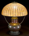 Decorative Arts, American:Lamps & Lighting, TIFFANY STUDIOS GEOMETRIC GLASS SHADE WITH HUBBELL BASE . Bronzelamp base with tiled leaded glass shade in a rose and white...(Total: 2 Items)